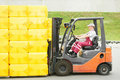 Worker driver at warehouse forklift Stock Images