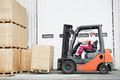 Worker driver at warehouse forklift loader works Royalty Free Stock Photo