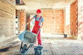 Worker With Empty Wheelbarrow ...