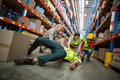 Worker fallen down while carrying cardboard boxes Royalty Free Stock Photo