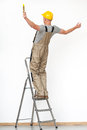 Worker falling from ladder with yellow helmet aluminium Royalty Free Stock Image