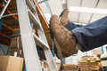 Worker falling off ladder in warehouse low section of the Stock Image