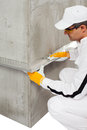 Worker fixing a lath on a corner cement Royalty Free Stock Images
