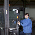 Worker with fork lift truck Royalty Free Stock Photo