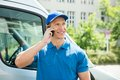Worker In Front Truck Talking On Mobile Phone Royalty Free Stock Photo