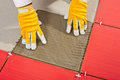Worker with a glass tile adhesive Royalty Free Stock Image