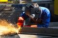 Worker grinding/welding Stock Photography