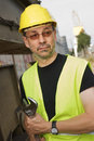 Worker with hard hat and wrench Stock Image