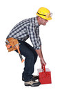 Worker with a heavy tool box red Royalty Free Stock Photography