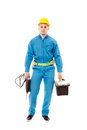 Worker with helmet holding a drill and a tool box full length studio portrait of handsome wearing overalls isolated over white Stock Image