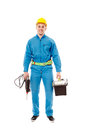 Worker with helmet holding a drill and a tool box full length studio portrait of handsome wearing overalls isolated over white Royalty Free Stock Image