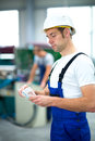 Worker with his wages on workplace Stock Photography