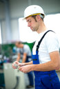 Worker with his wages on workplace Stock Photo