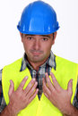 Worker holding his hands up construction Stock Image