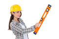 Worker holding a spirit level. Royalty Free Stock Photo