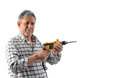 A worker holds an electric drill old man in studio Royalty Free Stock Photography