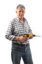 A worker holds an electric drill old man in studio Royalty Free Stock Photos