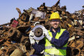 Worker on junkyard hold rotor like shiny trophy Royalty Free Stock Photo