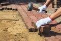 Worker laying concrete paving blocks. Royalty Free Stock Photo