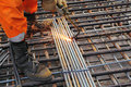 Worker legs weld metal grating