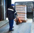 Worker loading on truck forklift Royalty Free Stock Photography