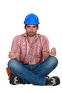 Worker in the lotus position a construction Royalty Free Stock Images