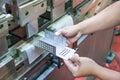 Worker at manufacture workshop operating cidan folding machine Stock Photo