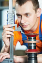 Worker measuring cutting tool Royalty Free Stock Photo