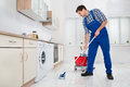 Worker Mopping Floor In Kitchen Royalty Free Stock Photo