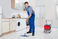 Worker Mopping Floor Royalty Free Stock Photo