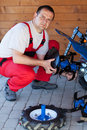 Worker mounting the tilling accessory on a cultivator machine Royalty Free Stock Photography