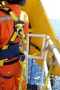 stock image of  Worker at offshore with safety harness.