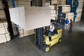 Worker operating a forklift truck in lumber industry manual Royalty Free Stock Photo