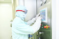 Worker operating pharma fluid bed system Royalty Free Stock Photo
