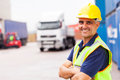 Worker outside warehouse cheerful senior shipping company standing with arms crossed Stock Photography