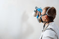 Worker painting wall with spray gun in white color. Royalty Free Stock Photo