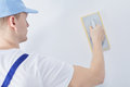 Worker with plastering trowel Royalty Free Stock Photo