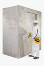 Worker preparing a putty cement to fix hole of wall Royalty Free Stock Photo