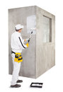 Worker priming with a paint roller cement wall Stock Photography