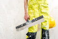 Worker with putty knife construction over obsolete background Stock Photography