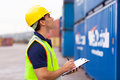 Worker recording containers warehouse in shipping company Royalty Free Stock Image