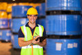 Worker recording stock portrait of young in warehouse Royalty Free Stock Photo