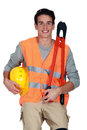 Worker in a reflective vest with helmet and boltcutters Royalty Free Stock Images