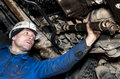 The worker repairs the car mechanic working on a broken down vehicle Royalty Free Stock Images