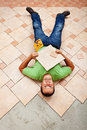 Worker resting on ceramic floor tiles man taking a short break Royalty Free Stock Images