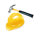 Worker s hard hat and hammer on white Stock Image