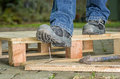 Worker with safety boots steps on a nail Royalty Free Stock Photography