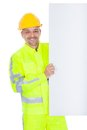 Worker in safety jacket presenting empty board Stock Photo