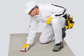 Worker sand paper clean cement substrate Stock Image