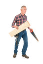 Worker with saw and timber senior manual Stock Images
